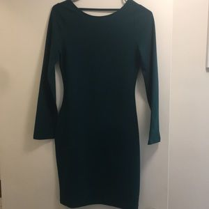 Long sleeved green dress with open back accent
